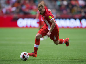 Canada's Scott Arfield moves the ball against Mexico during second half FIFA World Cup qualifying soccer action in Vancouver, B.C., on Friday March 25, 2016. THE CANADIAN PRESS/Darryl Dyck