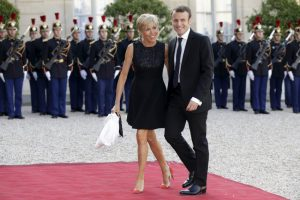 French Economy minister Emmanuel Macron and his wife Brigitte Trogneux arrive at the Elysee Palace in Paris, France, to attend a dinner in honour of Spain's King Felipe VI and Queen Letizia, June 2, 2015. REUTERS/Philippe Wojazer - RTR4YJV3
